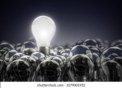 Illuminated light bulb standing Out in Crowd. Concept of idea and innovation,3d render