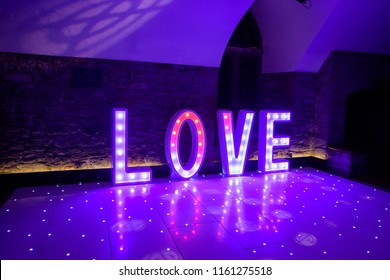 Illuminated Love sign in large letters at a wedding reception ready for the First Dance
