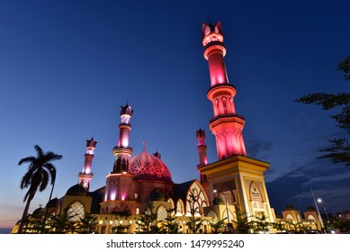 Illuminated minarets of the biggest mosque in Lombok, Islamic Center in Lombok Island, Indonesia