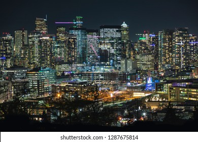 Illuminated Modern City Building Lights Background of Seattle Skyline
