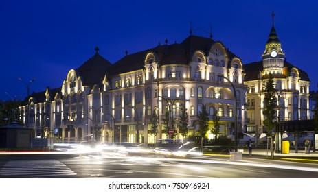 Illuminated monumental building of hotel in Oradea, Romania