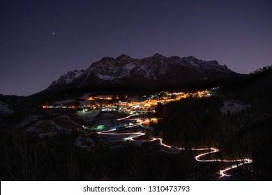Illuminated mountain village at night