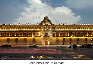 Illuminated National Palace in Plaza de la Constitucion of Mexico City at sunset. Zocalo and Army Square are among other local names of this place.