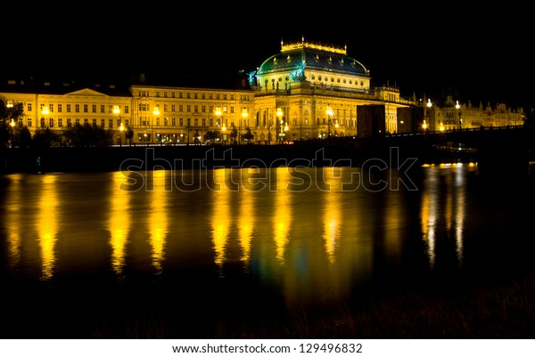 illuminated national theater in Prague at night