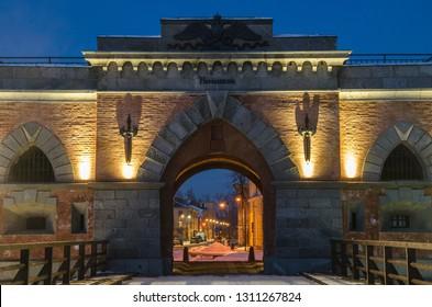 Illuminated Nicholas gate - Main gate of Daugavpils fortress in winter evening. Restoration project of Nicholas Gate – best in 2013 in Latvia. Gate built in 1824 - 1827 in Neo-Gothic style.