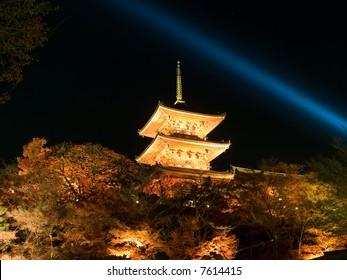 Illuminated night time view of the main pagoda tower of Kiyomizu Temple in Kyoto, Japan