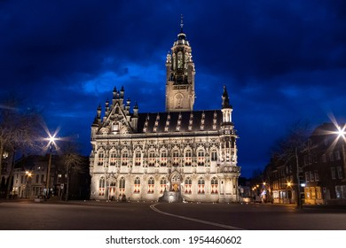 Illuminated night view of the beautiful old medieval gothic town hall of Middelburg, situated at the market square. Construction was completed in 1520.Middelburg, Zeeland, Netherlands - April 10, 2021