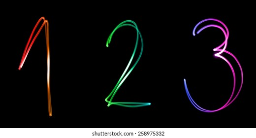 Illuminated numbers, counting from one to three in different colors