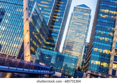 Illuminated office building and South Quay footbridge in Canary Wharf, London