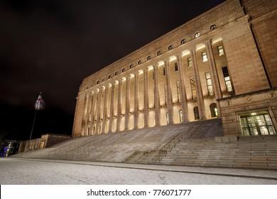 Illuminated parliament of Finland at night in Helsinki