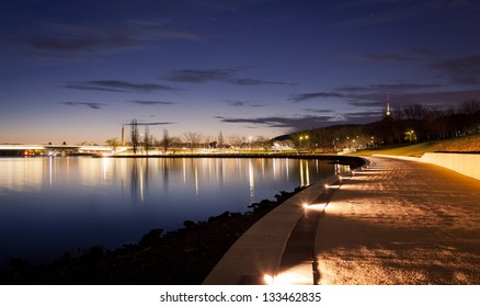 Illuminated path along the waters of Lake Burley Griffin in Canberra, Australian Capitol Territory. Australia.