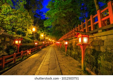 Illuminated path at night from the red lanterns leading from Yasaka Shrine to the Gion weeping cherry tree in Maruyama Park. Gion Shrine is one of the most famous shrines in Kyoto, Japan .