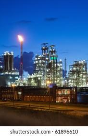 Illuminated petrochemical plant in twilight (Antwerp port, Belgium)