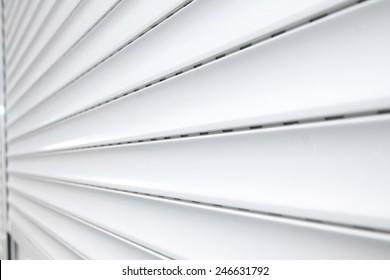Illuminated plastic roller shutter door