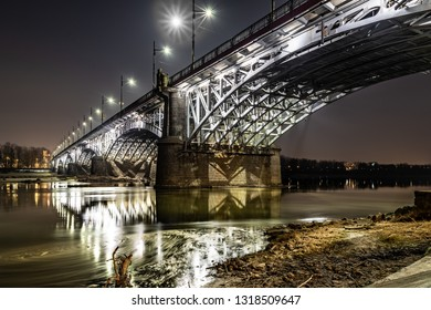Illuminated Poniatowski Bridge in Warsaw on the Vistula River