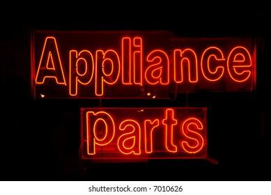 Illuminated red appliance parts neon sign