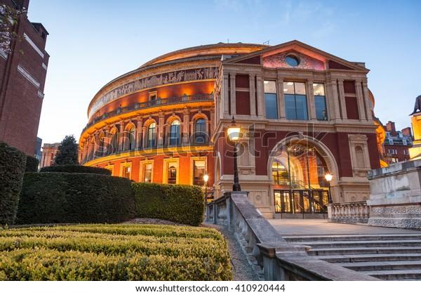 Illuminated The Royal Albert Hall in London at dusk