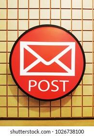 An illuminated sign of post