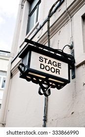 An illuminated sign for a stage door at a London theatre