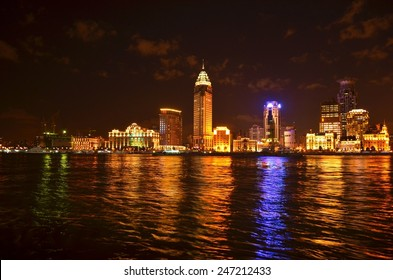 illuminated skyline of the bund area of shanghai.