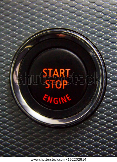 Illuminated Start Stop engine button in a sport car