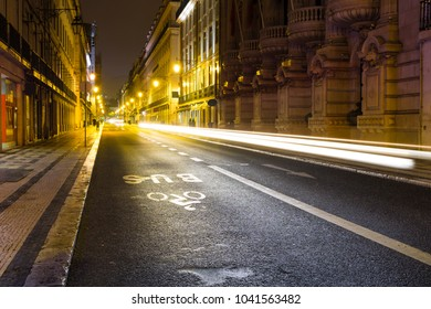 Illuminated street of old european town at night