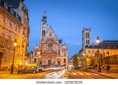 Illuminated streets of Paris during the blue hour in the evening, with Saint-Etienne-du-Mont church, Paris, France