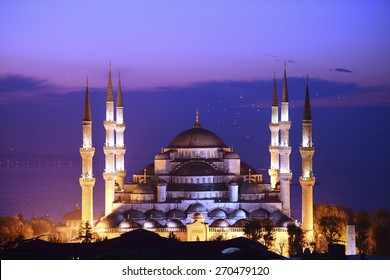 Illuminated Sultan Ahmed Mosque (Blue Mosque) before sunrise, Istanbul, Turkey