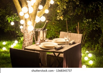 Illuminated table for two in the summer evening