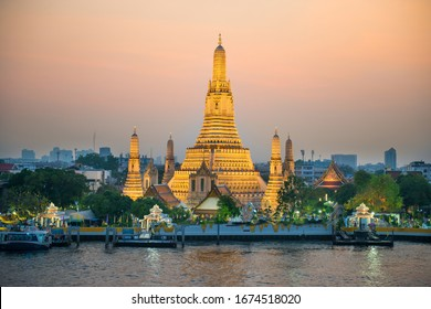 Illuminated Temple of Dawn or Wat Arun at sunset. Bangkok, Thailand