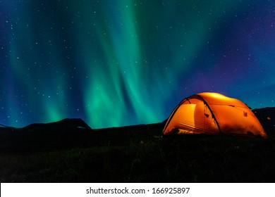 illuminated Tent and northern lights