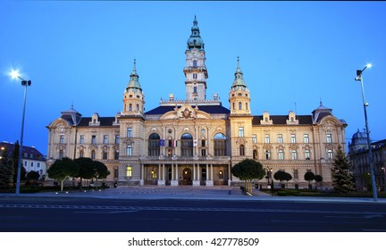 Illuminated town hall of the Hungarian city Gyor at dusk
