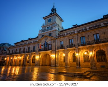 Illuminated townhall of Oviedo with blue sky at daybreak, Spain