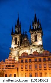 Illuminated Tyn church in Prague old town square