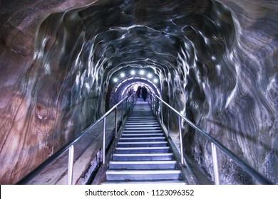 Illuminated underground entrance of Turda salt mine, Cluj, Romania