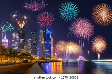 The illuminated urban skyline of Doha, Qatr, with fireworks for a celebration event