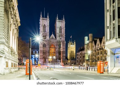 Illuminated Westminster abbey in the night, London, UK