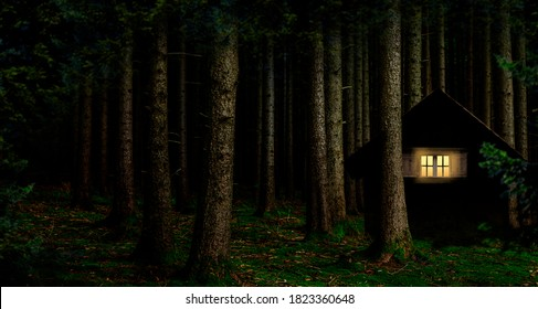 Illuminated window in a cabin in the woods at night - Shutterstock ID 1823360648