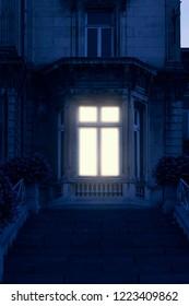 Illuminated window of historical mansion.