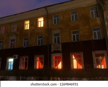 illuminated Windows of an old house in russia