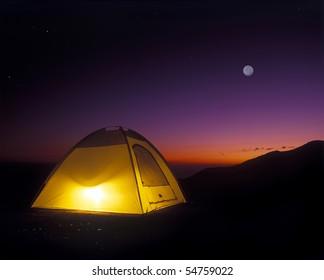 Illuminated Yellow Camping tent at Night