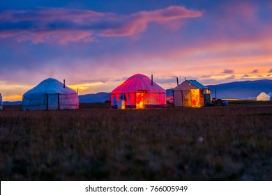 Illuminated yurt in twilight by Song Kul lake, Kyrgyzstan
