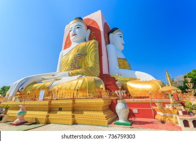 Illuminating Sunlight, Kyaik Pun Buddha the big Four Seated Buddha statues Shrine Sitting Back to Back of Four Directions on blue sky, Bago (Pegu), Myanmar.