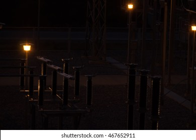 Illumination of the electric lamp in the switch yard at night .
