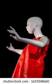 Illumination of a manikin and a red dress