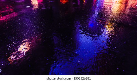 Illumination and neon night lights of NYC. Abstract image of neon lights on the streets of New York City. Multiple exposure and intentional motion blur
