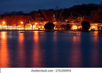 Illumination of the small town of Ilsenburg is reflected in the Water