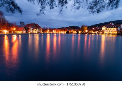 Illumination of the small town of Ilsenburg is reflected in the Water sea