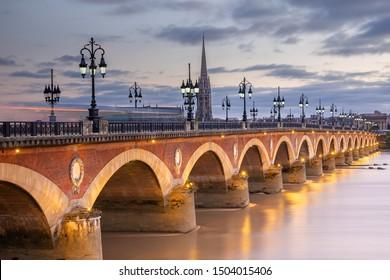 Illumination of the stone bridge of the city of Bordeaux.