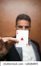 The illusionist performing with card